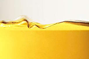 Close up of oil in glassの写真素材 [FYI03498515]