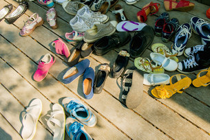 Large group of shoes on wooden planksの写真素材 [FYI03499183]