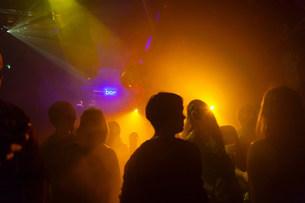 Nightclub scene with people dancing, disco ball, lighting eqの写真素材 [FYI03501228]