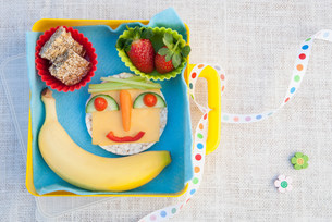 Healthy food products made into smiley faceの写真素材 [FYI03503590]