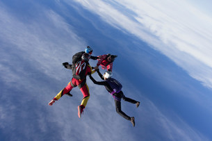 Small group of skydivers in formationの写真素材 [FYI03505271]
