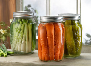 Three jars of pickled vegetables on windowsillの写真素材 [FYI03505275]