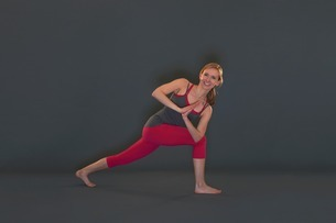 Woman in yoga pose on grey backgroundの写真素材 [FYI03506235]