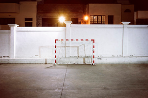 Football goal by wall at nightの写真素材 [FYI03508243]