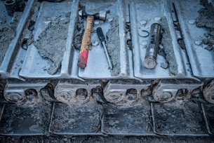 Repairs being made to bulldozer tracks at surface coal mine, close upの写真素材 [FYI03510282]