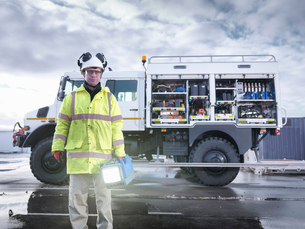 Portrait of Emergency Response worker with specialist equipment and rescue truckの写真素材 [FYI03513618]