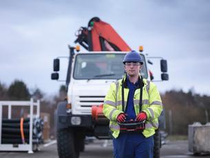 Portrait of Emergency Response Team worker training with truck craneの写真素材 [FYI03513639]