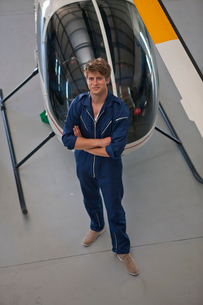 Student pilot posing in front of helicopterの写真素材 [FYI03515457]
