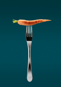Still life of fresh carrot on top of forkの写真素材 [FYI03517239]