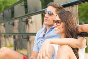 Young couple wearing sunglasses, smilingの写真素材 [FYI03517459]