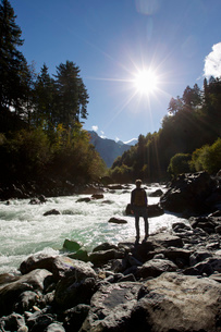 Rear view of male hiker looking out over river, Grindelwald, Switzerlandの写真素材 [FYI03517823]