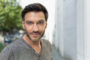 Portrait of handsome mature man on city streetの写真素材 [FYI03517855]