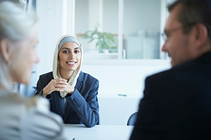 Over shoulder view of young businesswoman at interview in officeの写真素材 [FYI03519921]