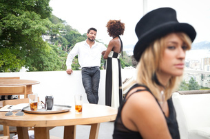 Couple on terrace, woman in foreground, Rio, Brazilの写真素材 [FYI03520206]