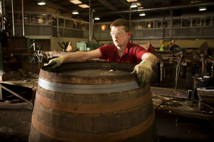 Young man making whisky cask at cooperageの写真素材 [FYI03520852]