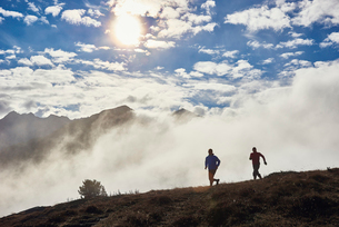 Two men trail running, Valais, Switzerlandの写真素材 [FYI03521345]
