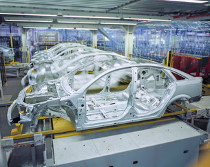 Car bodies on production line in car factoryの写真素材 [FYI03521690]