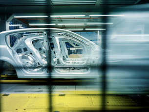 Car bodies on production line in car factoryの写真素材 [FYI03521692]