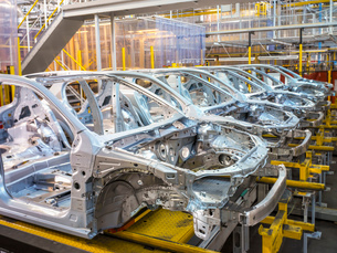 Car bodies on production line in car factoryの写真素材 [FYI03521699]