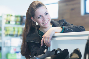 Portrait of smiling sales assistant in shoe shopの写真素材 [FYI03521883]