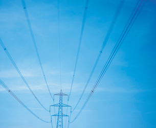 Wide angle view of electricity pylon against blue skyの写真素材 [FYI03521947]