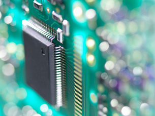 Close up of a circuit board used to connect electrical components to form a circuitの写真素材 [FYI03523805]