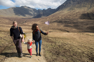 Family hiking in mountains, Fairy Pools, Isle of Skye, Hebrides, Scotlandの写真素材 [FYI03524301]