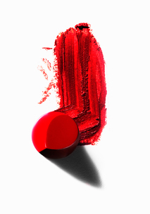 Abstract of piece of red lipstick with smudged lineの写真素材 [FYI03525446]