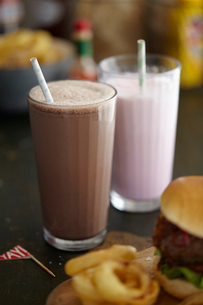 Milkshakes, burger and onion ringsの写真素材 [FYI03525903]