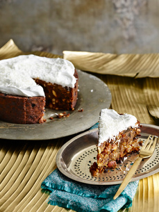 Sri Lankan Christmas Cake on silver serving dish with pastry forkの写真素材 [FYI03526487]