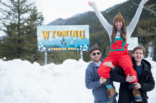 Men carrying woman on shoulder, Jackson Hole, Wyomingの写真素材 [FYI03528032]