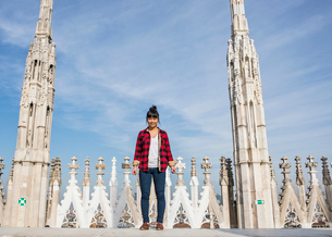 Woman standing on roof of Duomo Cathedral, Milan, Italyの写真素材 [FYI03528369]