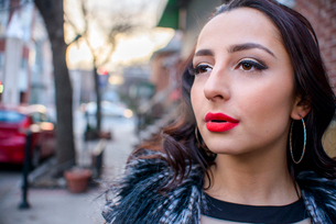 Close up of glamorous young woman on street wearing red lipstickの写真素材 [FYI03529093]