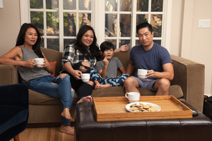 Family with boy relaxing on sofa and watching TVの写真素材 [FYI03530902]