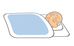 具合が悪くて寝ているおじいさんの写真素材 [FYI03534029]