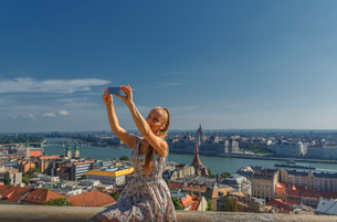 Mid adult woman taking self portrait using smartphone, Budapest, Hungaryの写真素材 [FYI03535794]