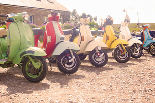 Colourful scooters parked in a rowの写真素材 [FYI03536153]