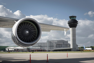 View of A380 jet engine and control tower at airportの写真素材 [FYI03536445]