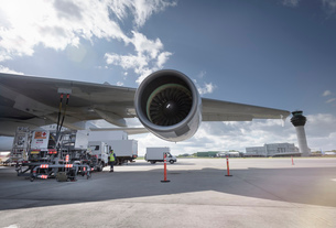 View of A380 jet engine and control tower at airportの写真素材 [FYI03536447]