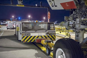 Tug for towing A380 aircraft on runway at nightの写真素材 [FYI03536683]