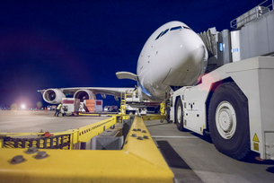 Night over A380 aircraft on stand at airportの写真素材 [FYI03536689]
