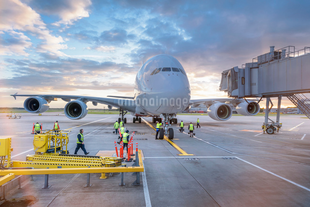 Ground crew attending to A380 aircraft at airportの写真素材 [FYI03536712]