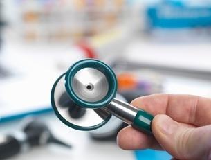 Doctor holding stethoscopeの写真素材 [FYI03537138]