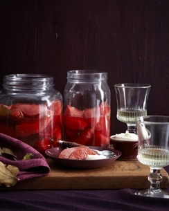 Dish and jars of homemade poached quince on cutting boardの写真素材 [FYI03538935]