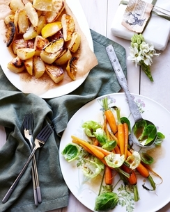 Overhead view of roast leon potatoes, carrots and brussel sprouts for christmas dinnerの写真素材 [FYI03538981]