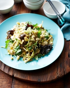 High angle view of mushroom and celery salad on blue plateの写真素材 [FYI03539052]