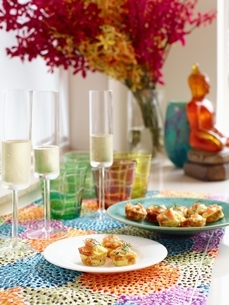 Ocean trout and chive frittatas with champagne flutes of sparkling champagneの写真素材 [FYI03539057]