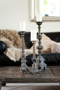 Three vintage candlesticks of living room coffee tableの写真素材 [FYI03540416]