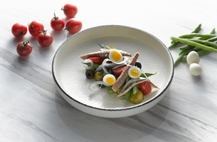 High angle view of San Remo tuna and egg salad on shallow serving dishの写真素材 [FYI03541000]