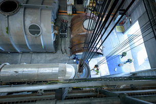 Engineers crane steam turbine parts during outage in gas-fired power stationの写真素材 [FYI03541740]